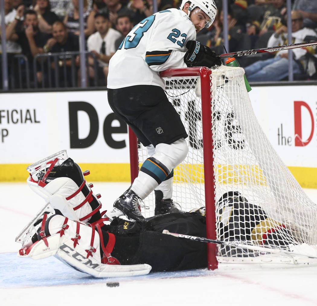 Golden Knights goaltender Marc-Andre Fleury (29) gets tripped up beside San Jose Sharks right wing Barclay Goodrow (23) during the second period of Game 2 of an NHL hockey second-round playoff ser ...