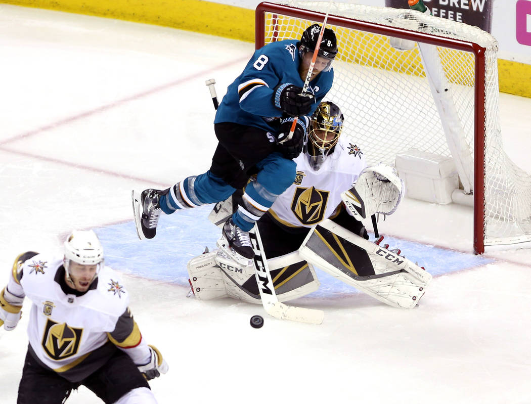 Vegas Golden Knights goaltender Marc-Andre Fleury (29) works to defend a shot against pressure from San Jose Sharks center Joe Pavelski (8) during the second period in Game 4 of an NHL hockey seco ...