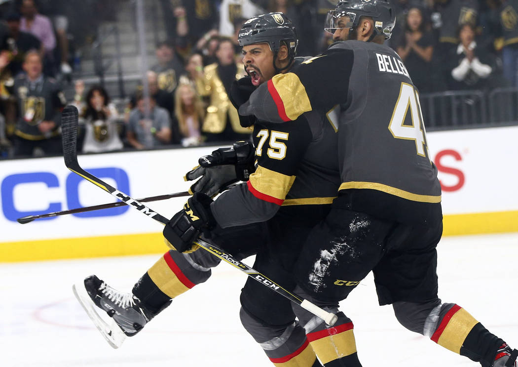 Golden Knights right wing Ryan Reaves (75) celebrates his goal against the Washington Capitals with left wing Pierre-Edouard Bellemare (41) during the third period of Game 1 of the NHL hockey Stan ...