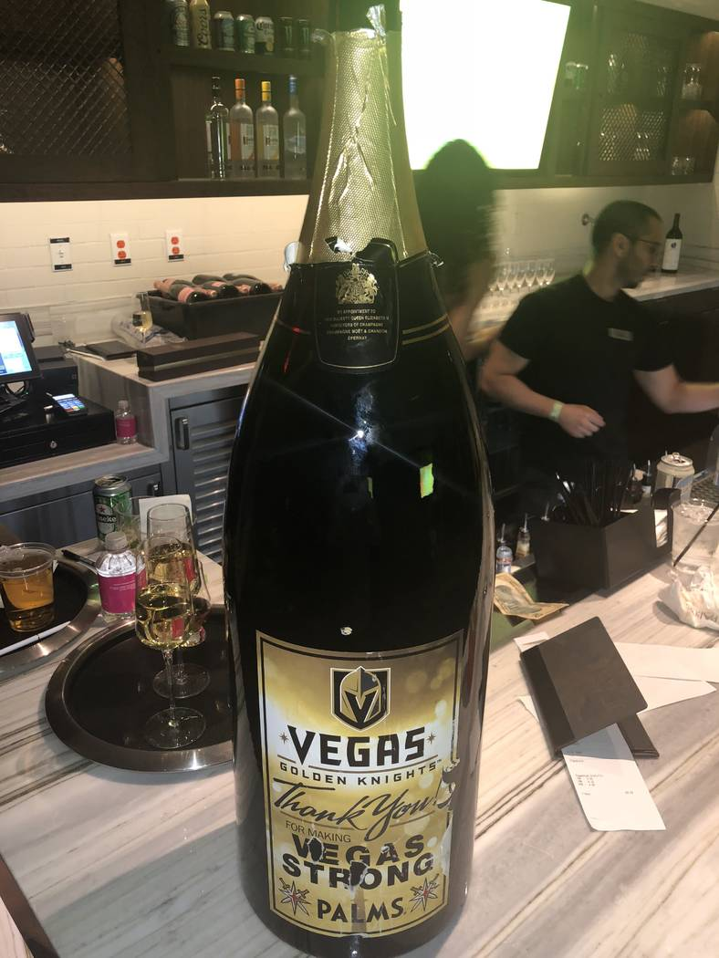 A somewhat weathered 15-liter bottle of Moet Chandon with a customized Vegas Golden Knights label his shown atop a VIP bar at Pearl at the Palms on Friday, June 9, 2018. (John Katsilometes/Las Veg ...