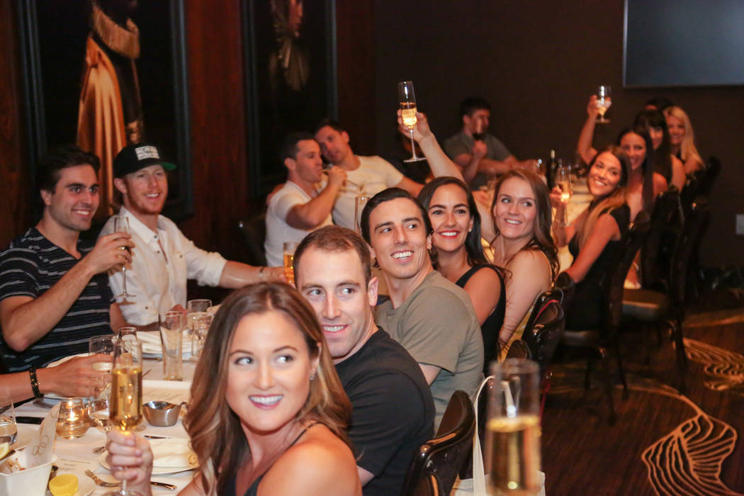 Members of the Vegas Golden Knights toast the 2017-18 season at Scotch 80 Prime at the Palms on Friday, June 8, 2018 (Edison Graff)