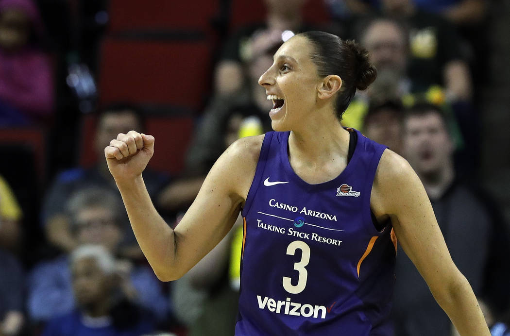 FILE - In this May 20, 2018, file photo, Phoenix Mercury's Diana Taurasi reacts to a call in their favor against the Seattle Storm in the first half of a WNBA basketball game, in Seattle. Taurasi ...
