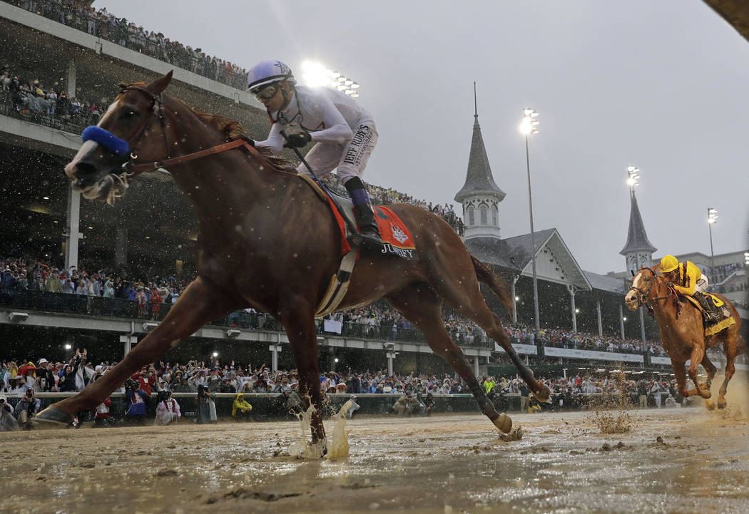 In this May 5, 2018, file photo, Justify, ridden by jockey Mike Smith wins the 144th running of the Kentucky Derby horse race at Churchill Downs in Louisville, Ky. Justify, who won the first two l ...