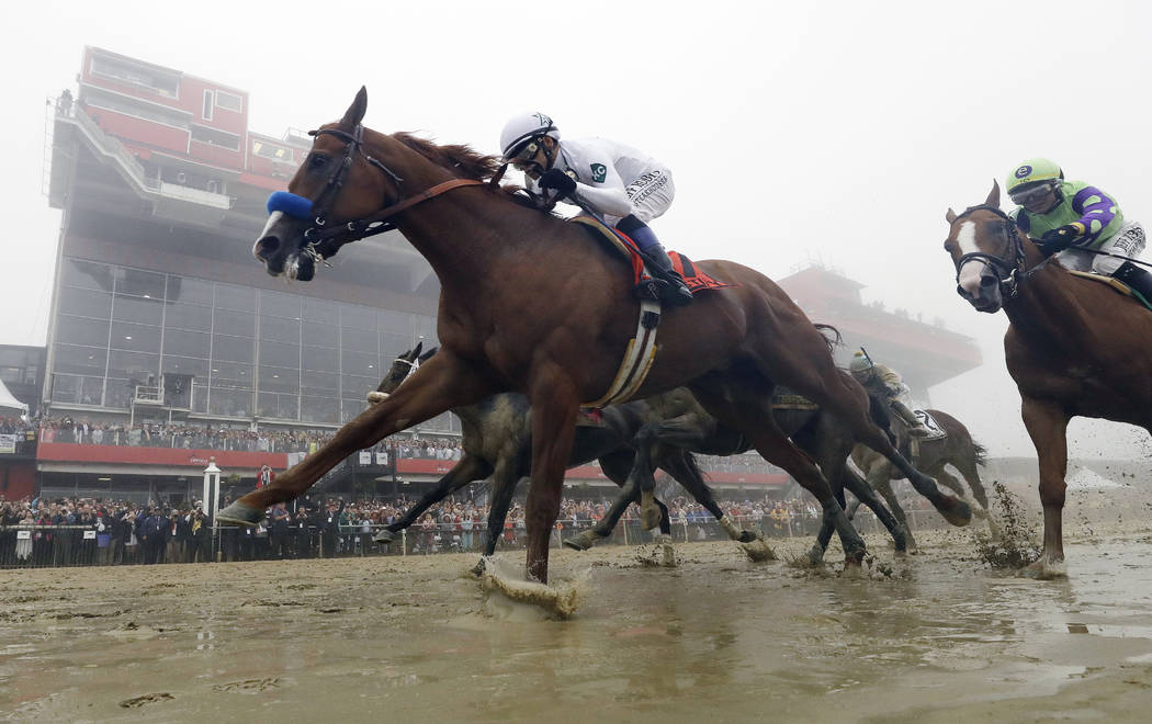 In this May 19, 2018, file photo, Justify, with Mike Smith aboard, wins the 143rd Preakness Stakes horse race at Pimlico race course in Baltimore. Justify, who won the first two legs, won the Belm ...