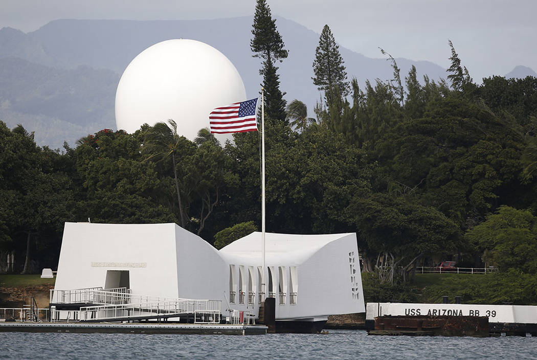 The USS Arizona Memorial, part of the World War II Valor in the Pacific National Monument, is seen at Joint Base Pearl Harbor-Hickam, Hawaii. (AP Photo/Carolyn Kaster, File)