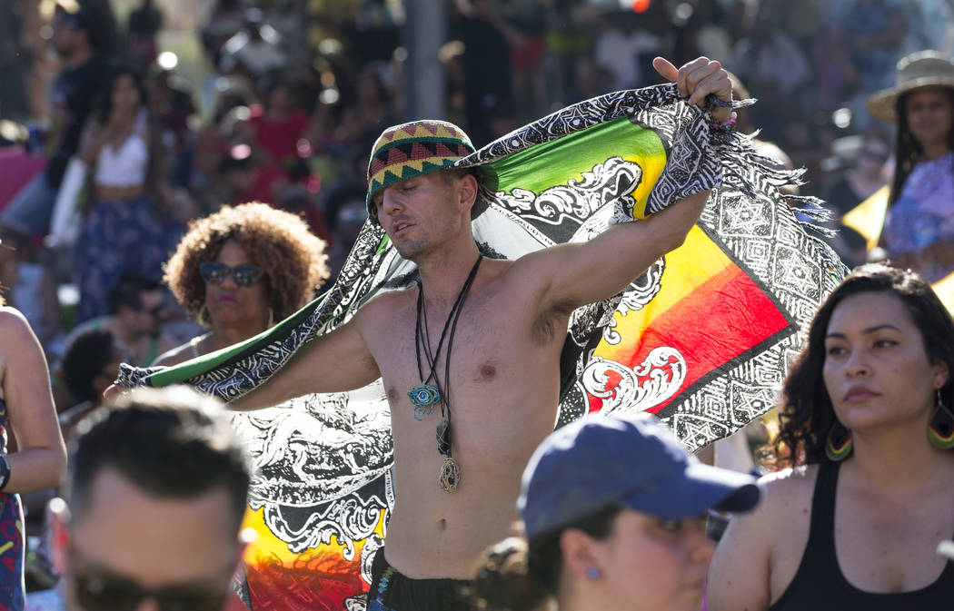 Las Vegas resident Adam Alcantara waives a Bob Marley flag during Reggae in the Desert at the Clark County Amphitheater in downtown Las Vegas on Saturday, June 9, 2018. Richard Brian Las Vegas Rev ...