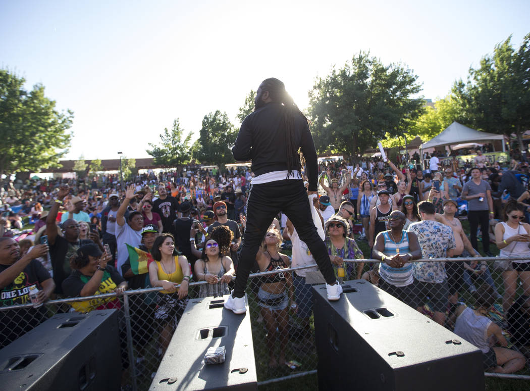 Jamaican singer Prestige performs atop the speakers during Reggae in the Desert at the Clark County Amphitheater in downtown Las Vegas on Saturday, June 9, 2018. Richard Brian Las Vegas Review-Jou ...