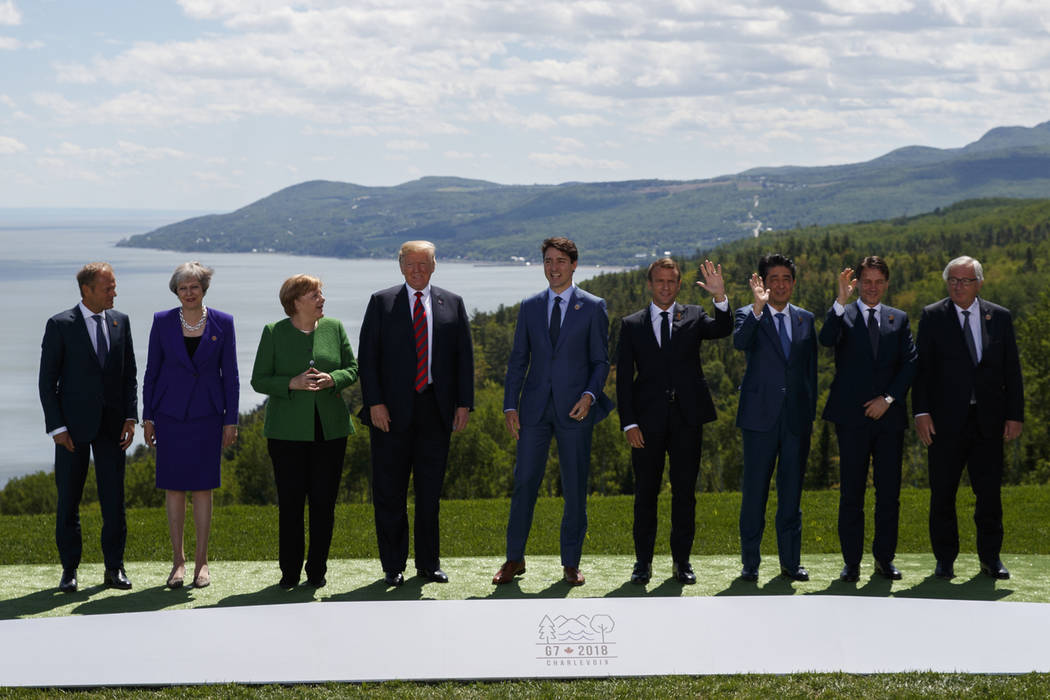 From left, President of the European Council Donald Tusk, British Prime Minister Theresa May, German Chancellor Angela Merkel, U.S. President Donald Trump, Canadian Prime Minister Justin Trudeau, ...