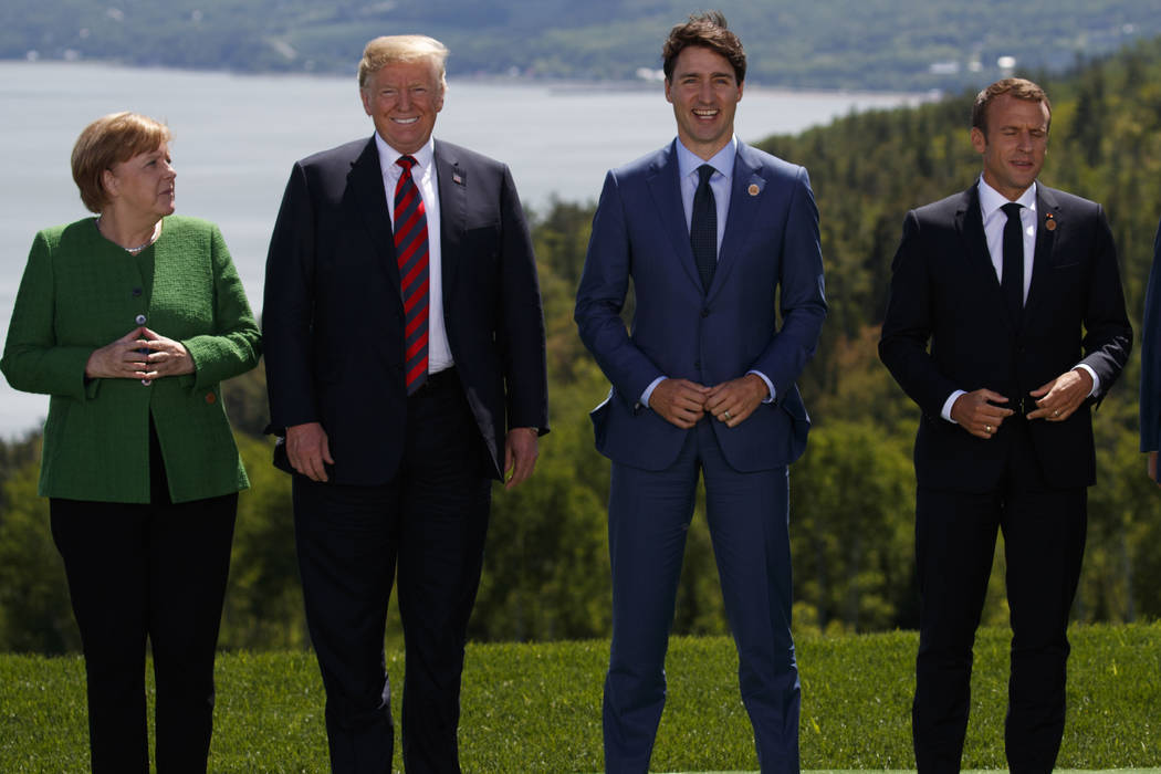 German Chancellor Angela Merkel President Donald Trump Canadian Prime Minister Justin Trudeau and French President Emmanuel Macron gather for the family