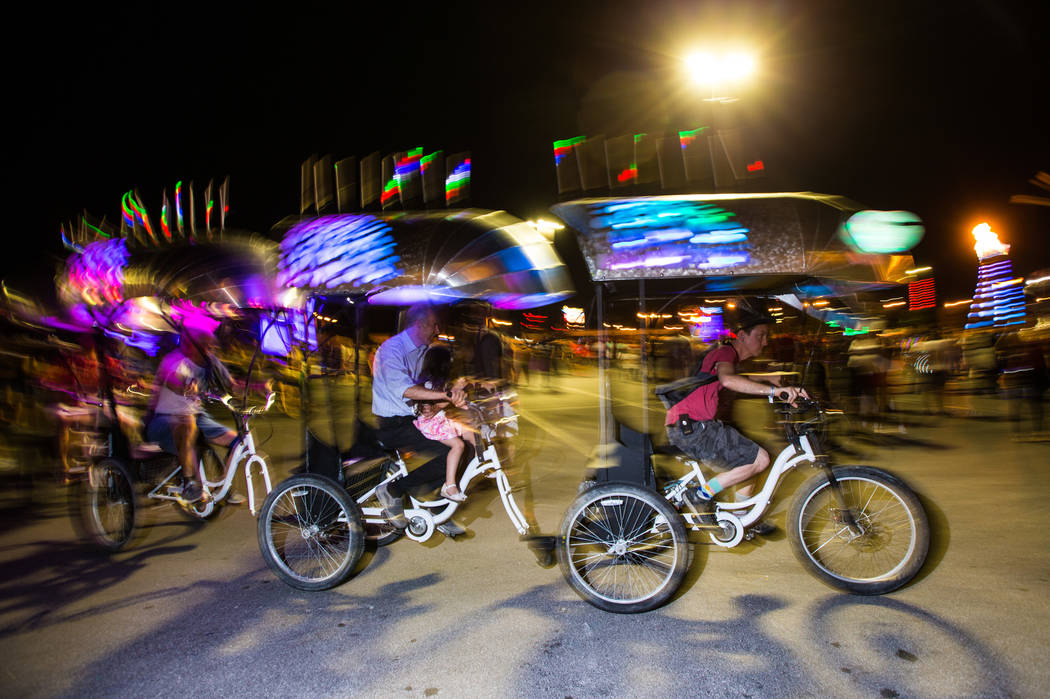 Attendees weave through the crowd along the Cosmic Space Worm during the Intergalactic Art Car Festival in downtown Las Vegas on Saturday, June 9, 2018. Chase Stevens Las Vegas Review-Journal @css ...