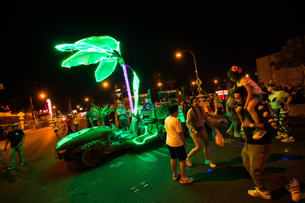 Attendees dance by an art car during the Intergalactic Art Car Festival in downtown Las Vegas on Saturday, June 9, 2018. Chase Stevens Las Vegas Review-Journal @csstevensphoto