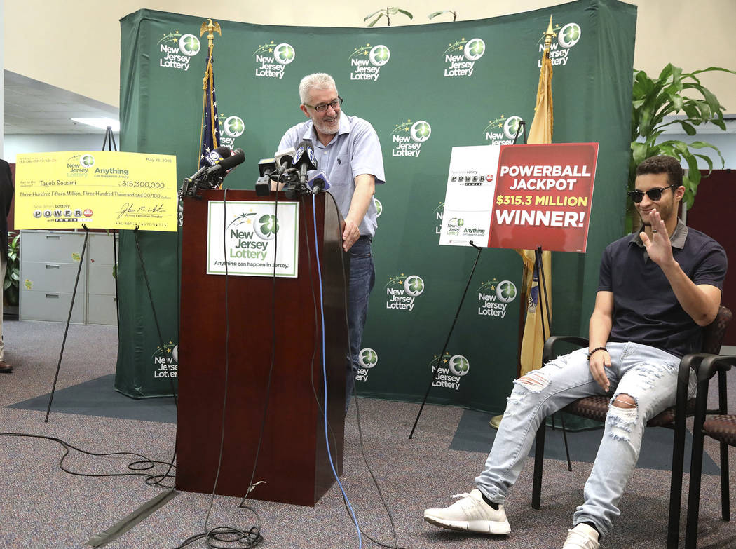 Tayeb Souami left of Little Ferry introduces his son Inel during a press conference announcing Souami as the $351.3 million Powerball winner Friday