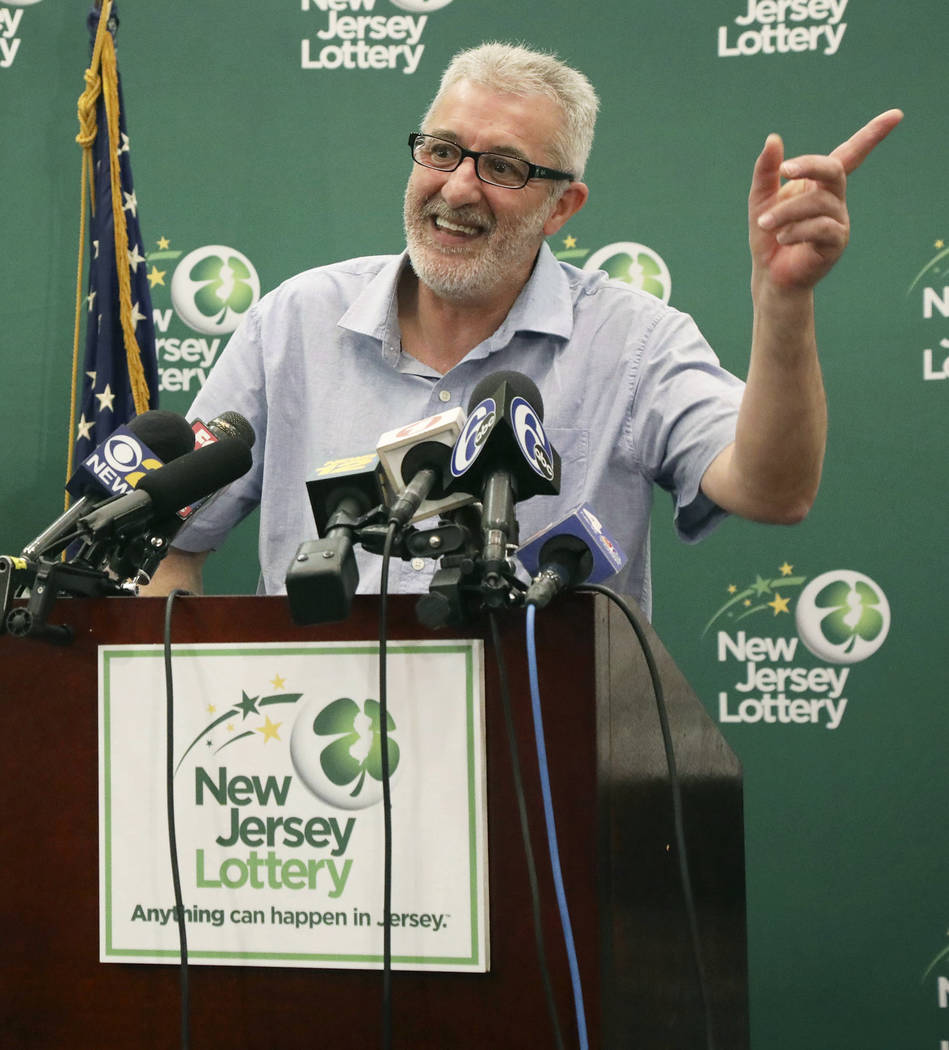 Tayeb Souami, of Little Ferry, gestures as he is introduced as the $351.3 million Powerball winner, Friday, June 8, 2018, in Trenton, N.J. (Chris Pedota/The Record via AP)