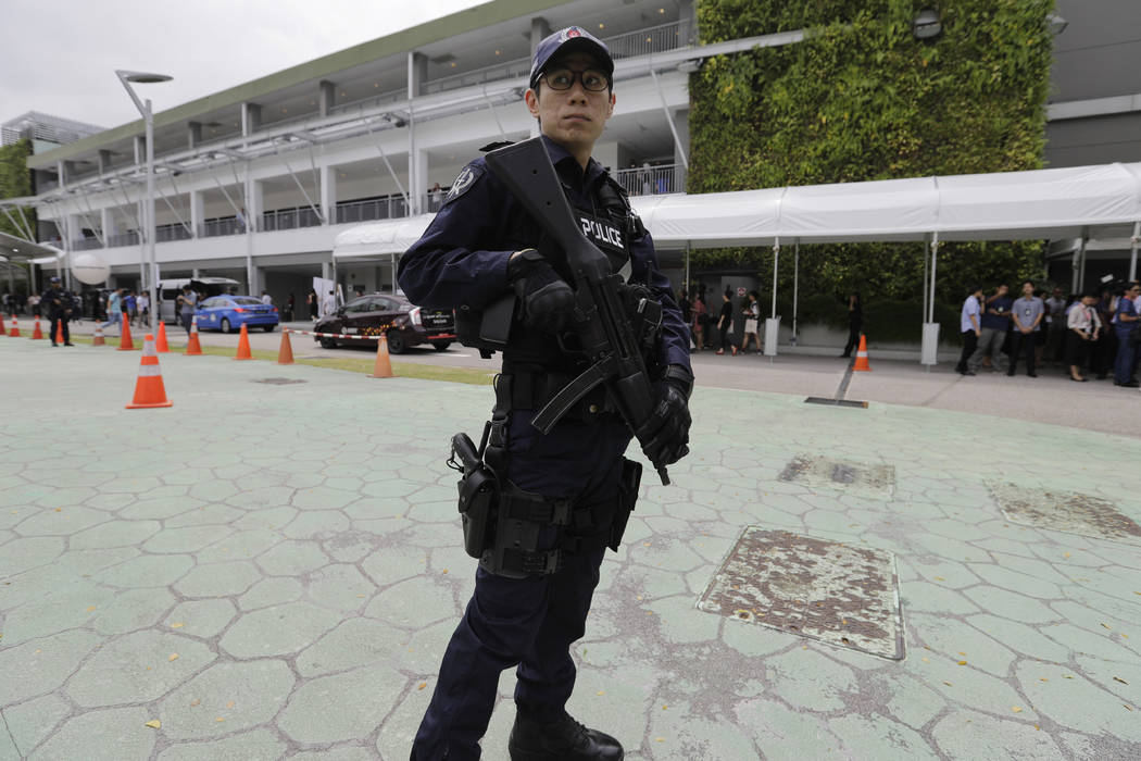 A police officer guards the entrance of the international media center Sunday, June 10, 2018, in Singapore ahead of the summit between U.S. President Donald Trump and North Korean leader Kim Jong ...