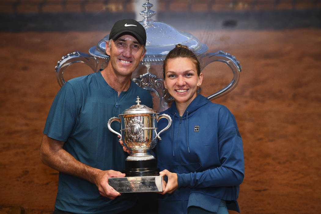 In this image provided by the French Tennis Federation (FFT) Romania's Simona Halep poses with her coach Darren Cahill in the Roland Garros stadium cloakroom with her cup after defeating Sloane St ...