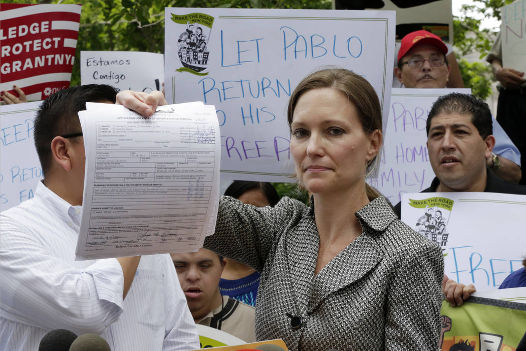 Legal Aid Society lawyer Jennifer WIlliams, who represents Ecuadorean restaurant worker Pablo Villavicencio, shows the Application for Stay of Deportation or Removal she filed at the offices of th ...