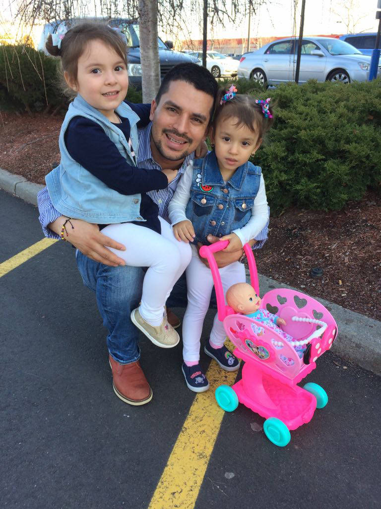 In this undated family photo provided by Sandra Chica, Pablo Villavicencio poses with his two daughters, Luciana, left, and Antonia. After Villavicencio couldn't produce a New York State Driver's ...
