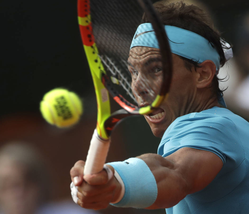Spain's Rafael Nadal plays a shot against Austria's Dominic Thiem in the men's final match of the French Open tennis tournament at the Roland Garros stadium in Paris, France, Sunday, June 10, 2018 ...