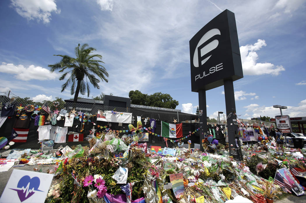 A makeshift memorial is shown outside the Pulse nightclub in Orlando, Fla., in this July 11, 2016, file photo. Survivors and victims' relatives are marking the second anniversary of the Pulse ni ...