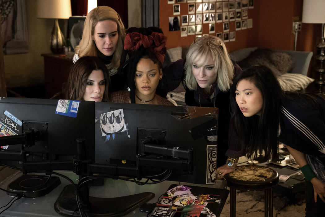 "This image released by Warner Bros. shows, from foreground left, Sandra Bullock Sarah Paulson, Rihanna, Cate Blanchett and Awkwafina in a scene from ""Ocean's 8."" (Barry Wetcher/Warner Br ..."