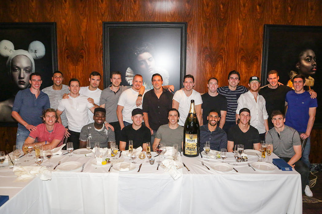 Members of the Vegas Golden Knights, with Palms General Manager Jon Gray (near the center in plumb-colored suit) in are shown during a party celebrating the close of the 2017-18 season at Scotch ...
