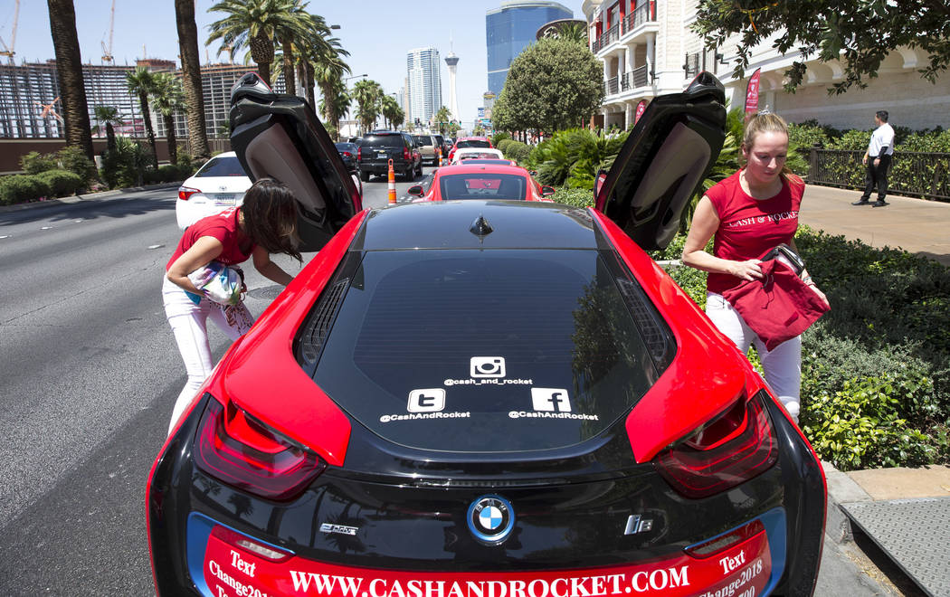 Participants Anna Jarvis, left, and Janine Robertson of London arrive in a BMW i8 at the Wynn Las Vegas at the conclusion of the Cash & Rocket tour on Sunday, June 10, 2018. Richard Brian Las ...