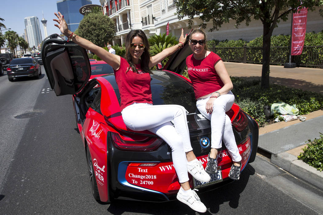 Participants Anna Jarvis, left, and Janine Robertson of London pose after arriving in a BMW i8 at the Wynn Las Vegas at the conclusion of the Cash & Rocket tour on Sunday, June 10, 2018. Richa ...