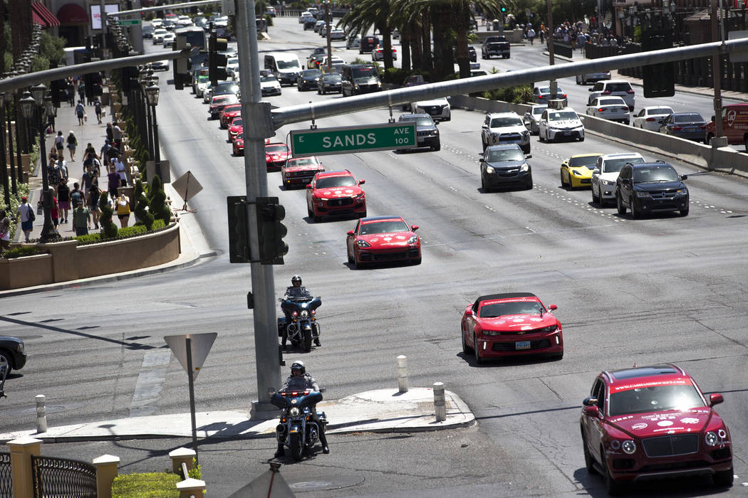 Participants in luxury vehicles arrive at the Wynn Las Vegas at the conclusion of the Cash & Rocket tour on Sunday, June 10, 2018. Richard Brian Las Vegas Review-Journal @vegasphotograph