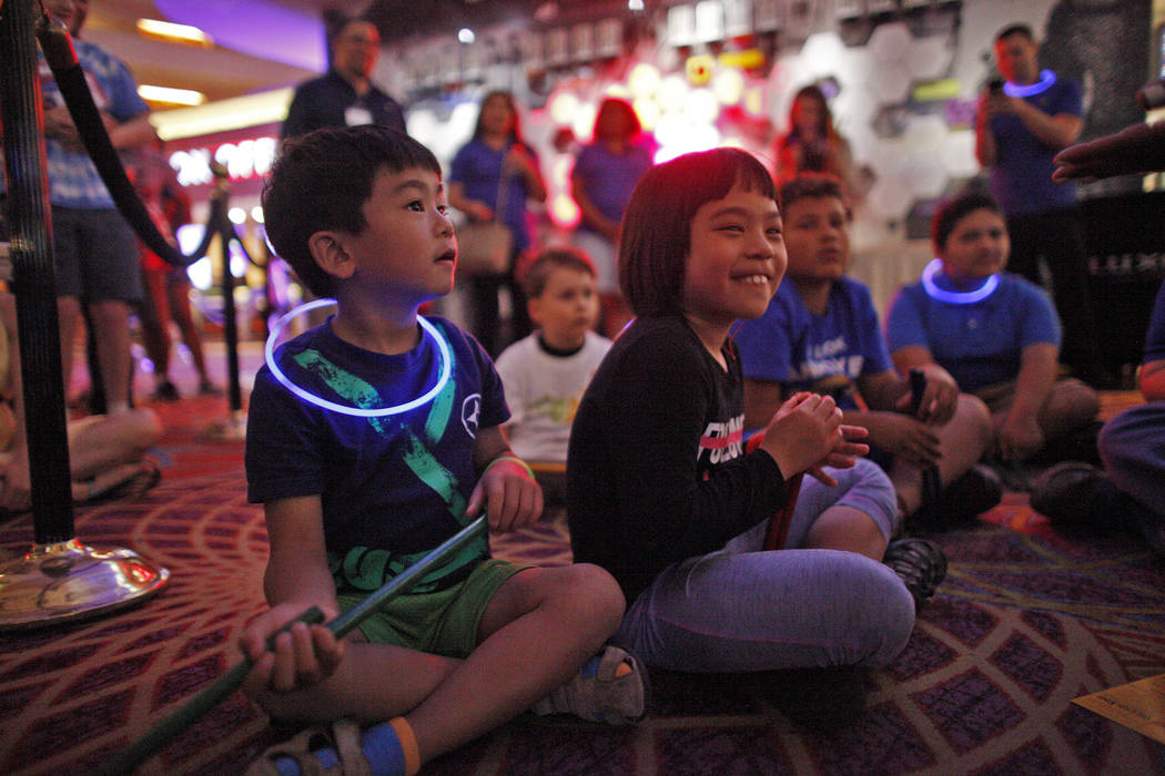 Analu Tam, 6, left, and his sister Kailana Tam, 9, laugh during a drum circle activity at the Luxor hotel-casino in Las Vegas, Sunday, June 10, 2018. The event took place before the Blue Man Group ...
