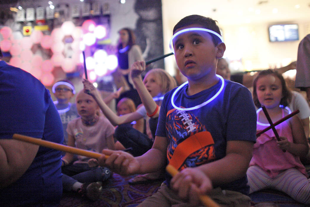 Leo Murphy, 11, follows along during a drum circle activity at the Luxor hotel-casino in Las Vegas, Sunday, June 10, 2018. The event took place before the Blue Man Groups' Grant a Gift Autism Foun ...