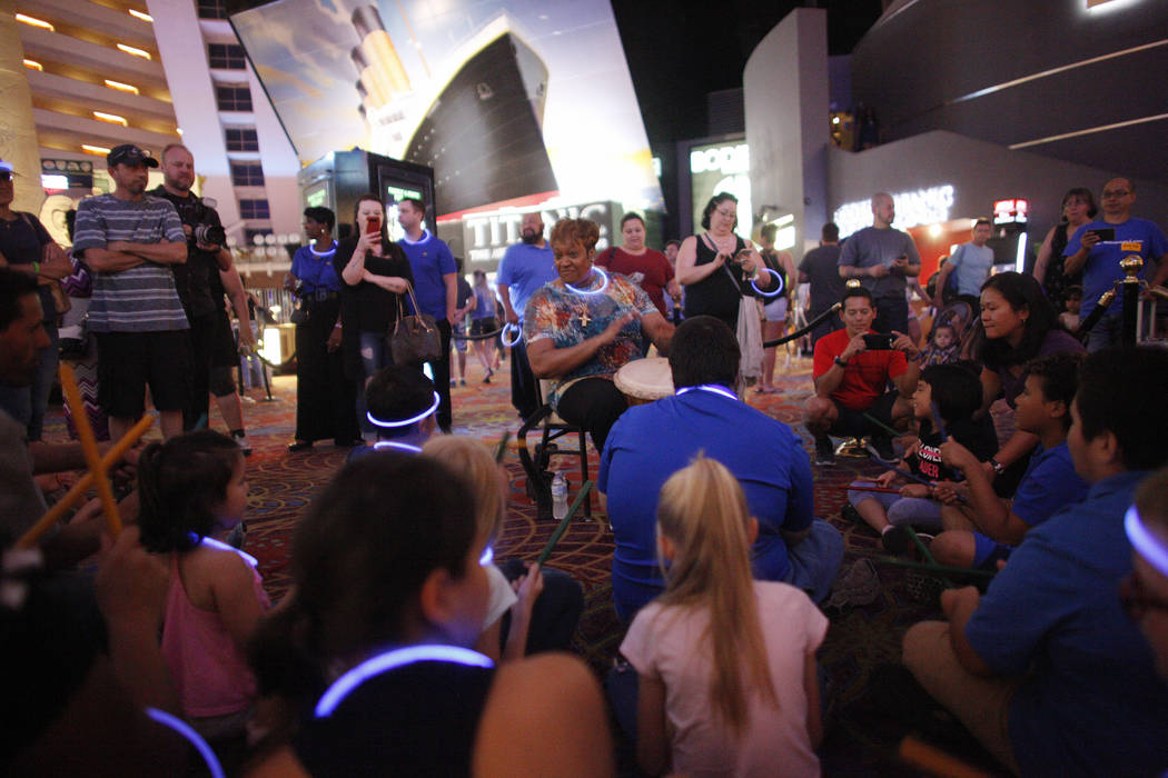 "Linda Austin, known as ""La"", a Smith Center master teacher artist, leads a drum circle at the Luxor hotel-casino in Las Vegas, Sunday, June 10, 2018. The event took place before the Blue ..."