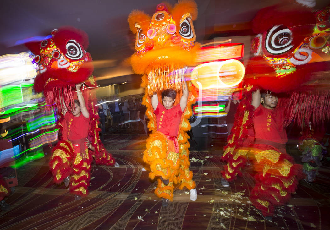 Dancers from the Lohan School of Shaolin perform a traditional Chinese lion dance during a grand opening event celebrating a new gaming pit area at the Stratosphere hotel-casino in Las Vegas on Fr ...