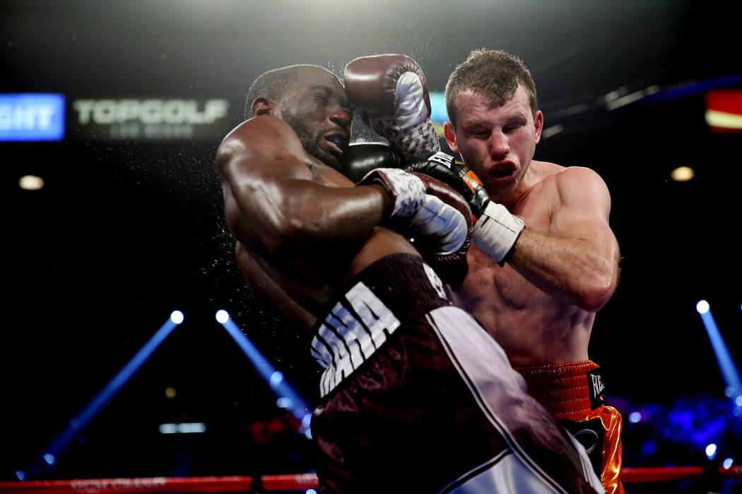 Terence Crawford, left, battles Jeff Horn in the WBO welterweight World Title bout at the MGM Grand Garden Arena in Las Vegas, Saturday, June 9, 2018. Crawford won by technical knockout in the nin ...