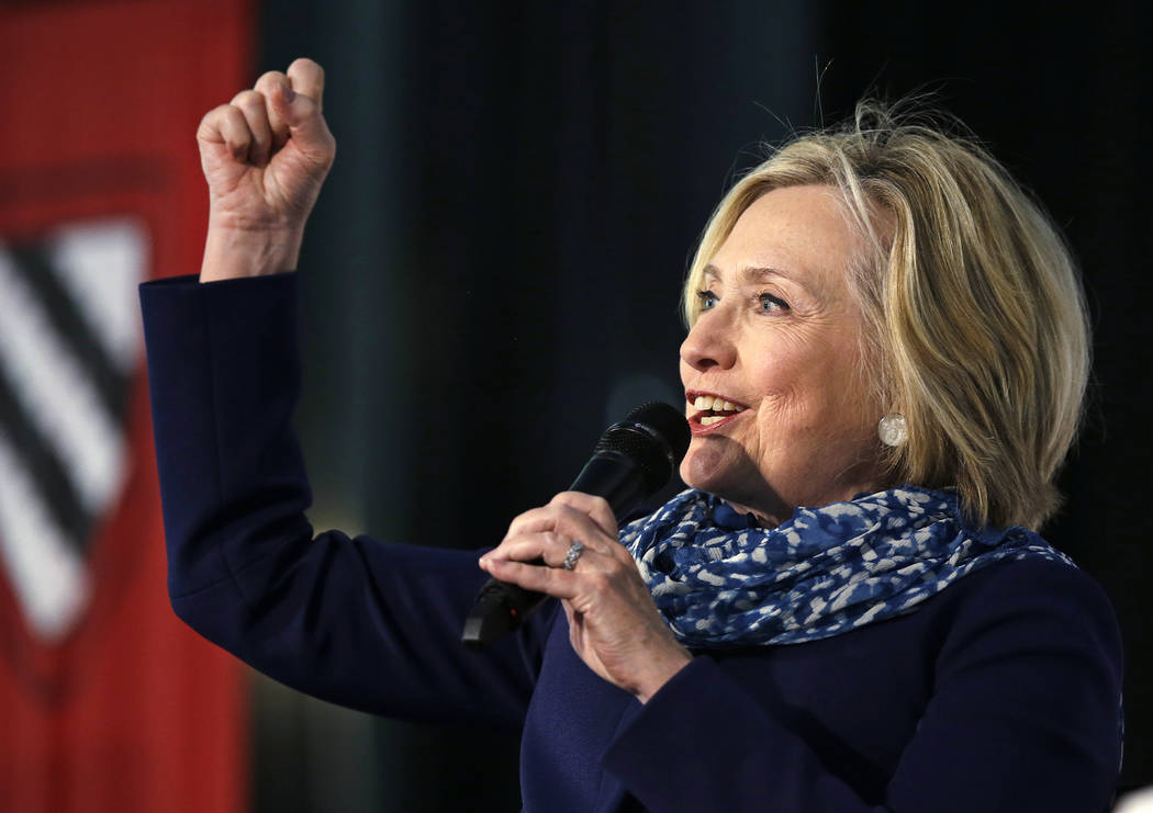 Hillary Clinton pumps her fist as she is introduced at Harvard University in Cambridge, Mass., Friday, May 25, 2018. Harvard University's Radcliffe Institute honored Clinton with the 2018 Radcliff ...