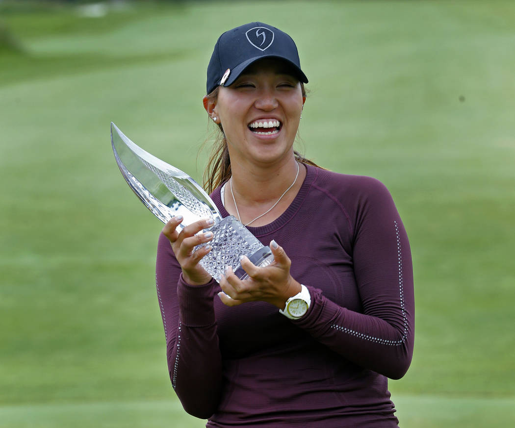 Annie Park poses with the trophy after winning the ShopRite LPGA Classic golf tournament Sunday, June 10, 2018, in Galloway, N.J. (AP Photo/Noah K. Murray)