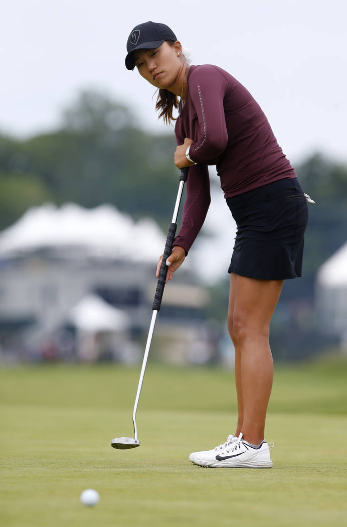 Annie Park watches her putt on the first hole during the third round of the ShopRite LPGA Classic golf tournament, Sunday, June 10, 2018, in Galloway, N.J. (AP Photo/Noah K. Murray)