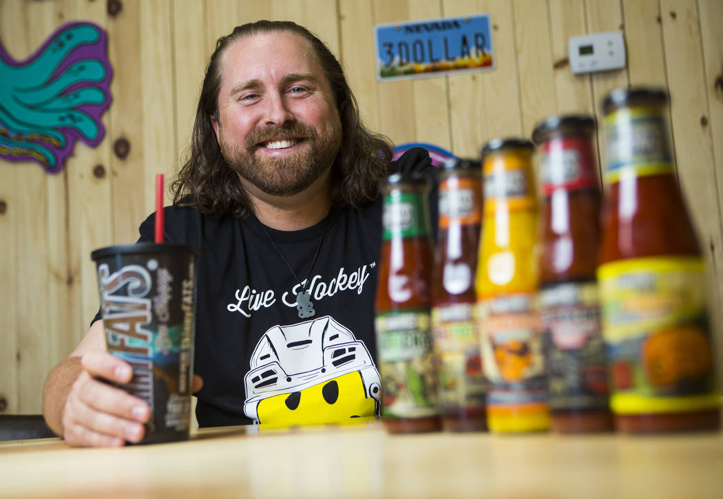 Reed Allen Slobusky, founder of SkinnyFats, poses with a variety of catchups in Las Vegas on Friday, June 8, 2018. Chase Stevens Las Vegas Review-Journal @csstevensphoto
