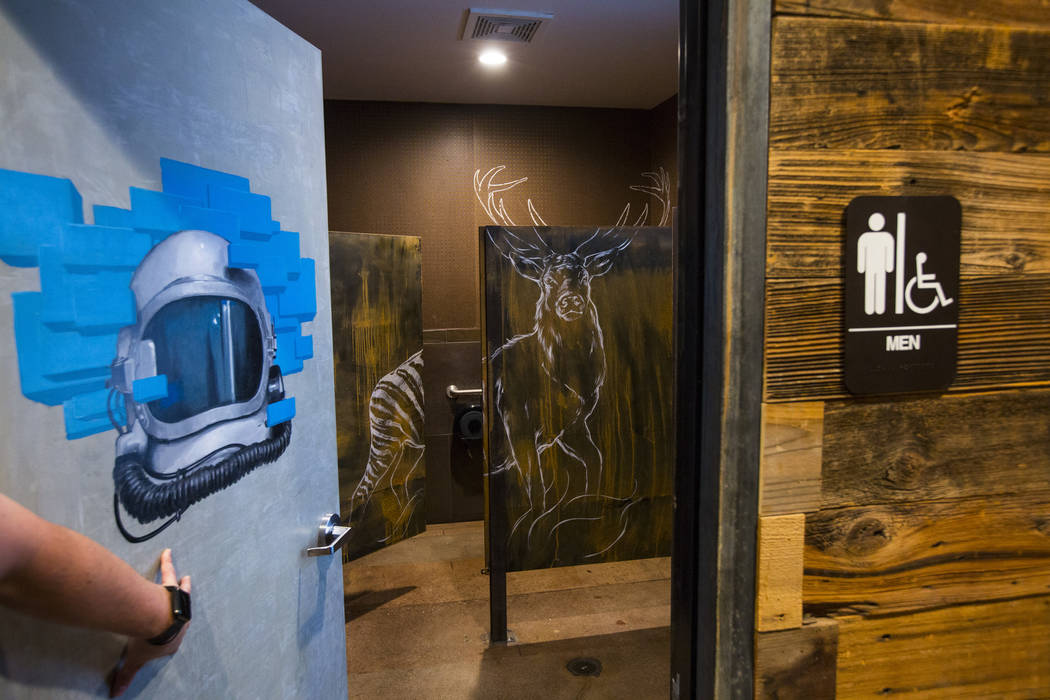Reed Allen Slobusky, founder of SkinnyFats, shows off the artwork in the restrooms in a new restaurant space next to the original restaurant location at 6261 Dean Martin Drive in Las Vegas on Frid ...