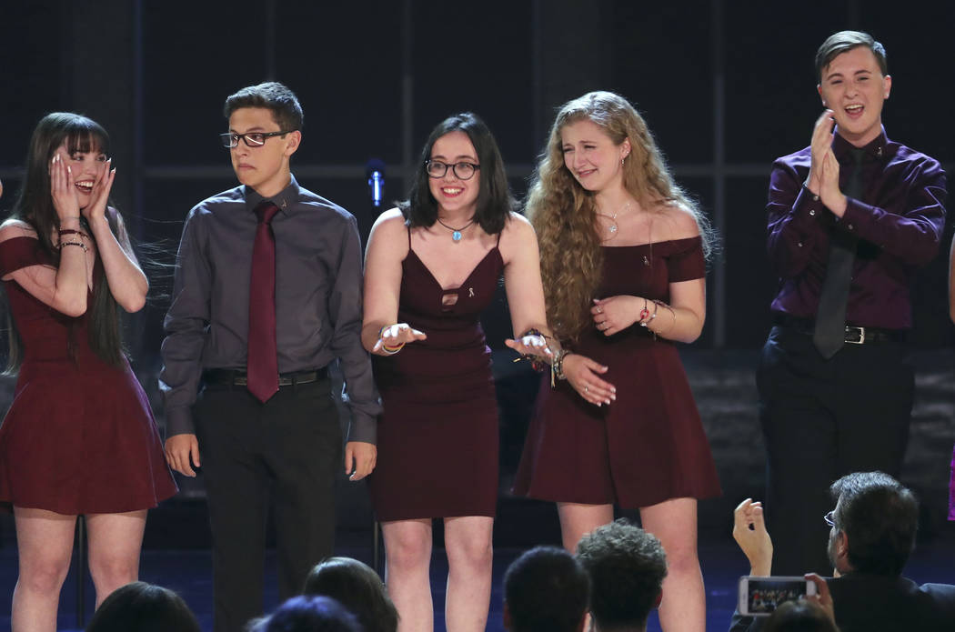 """Students from the Marjory Stoneman Douglas High School drama department react after performing """"Seasons of Love"""" at the 72nd annual Tony Awards at Radio City Music Hall on Sunday, June 1 ..."""