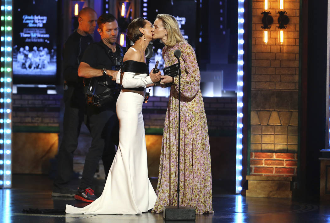 "Laurie Metcalf, left, kisses presenter Carey Mulligan as she accepts the award for best featured actress in a play for ""Edward Albee's Three Tall Women"" at the 72nd annual Tony Awards at ..."