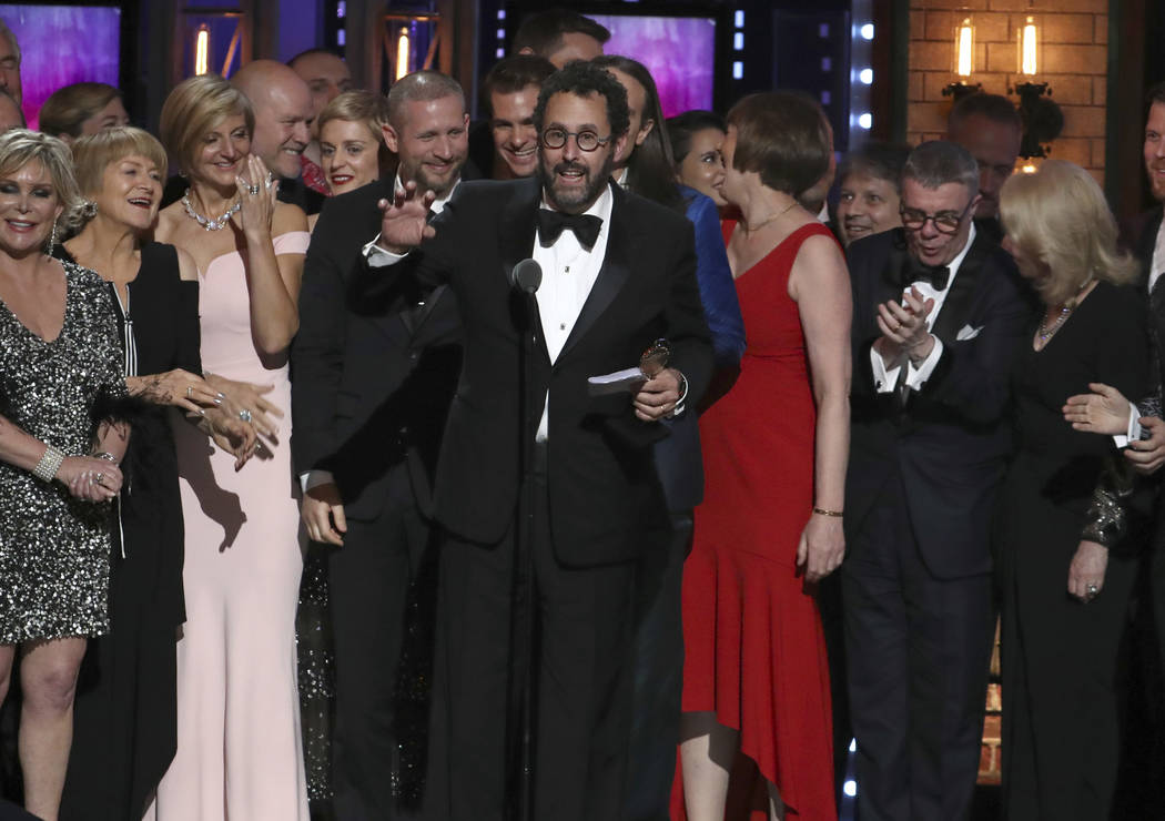 "Playwright Tony Kushner, center, and the cast and crew of ""Angels in America"" accept the award for best revival of a play at the 72nd annual Tony Awards at Radio City Music Hall on Sunda ..."