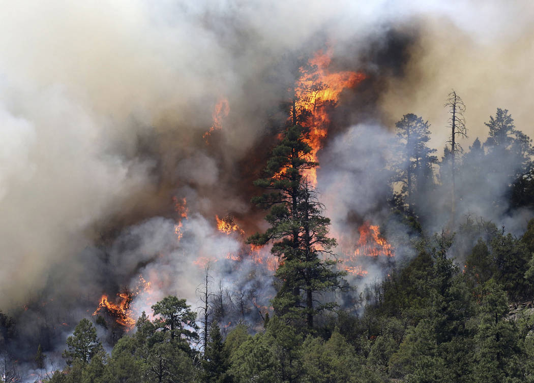 In this Saturday, June 9, 2018 photo, a wildfire burns on the east side of Hermosa Cliffs near Hermosa, Colo. (Jerry McBride/The Durango Herald via AP)/The Durango Herald via AP)