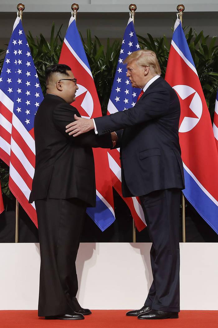 U.S. President Donald Trump shakes hands with North Korea leader Kim Jong Un at the Capella resort on Sentosa Island Tuesday, June 12, 2018 in Singapore. (AP Photo/Evan Vucci)