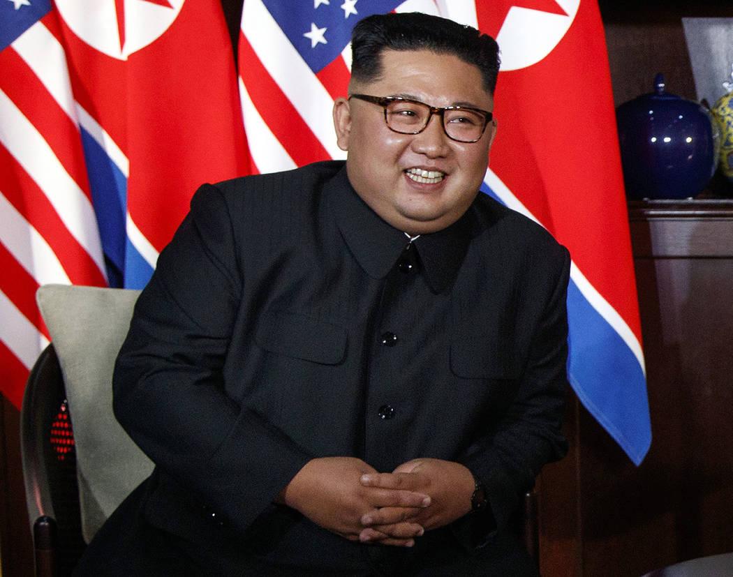 North Korean leader Kim Jong Un smiles as he meets with President Donald Trump on Sentosa Island, Tuesday, June 12, 2018, in Singapore. (AP Photo/Evan Vucci)