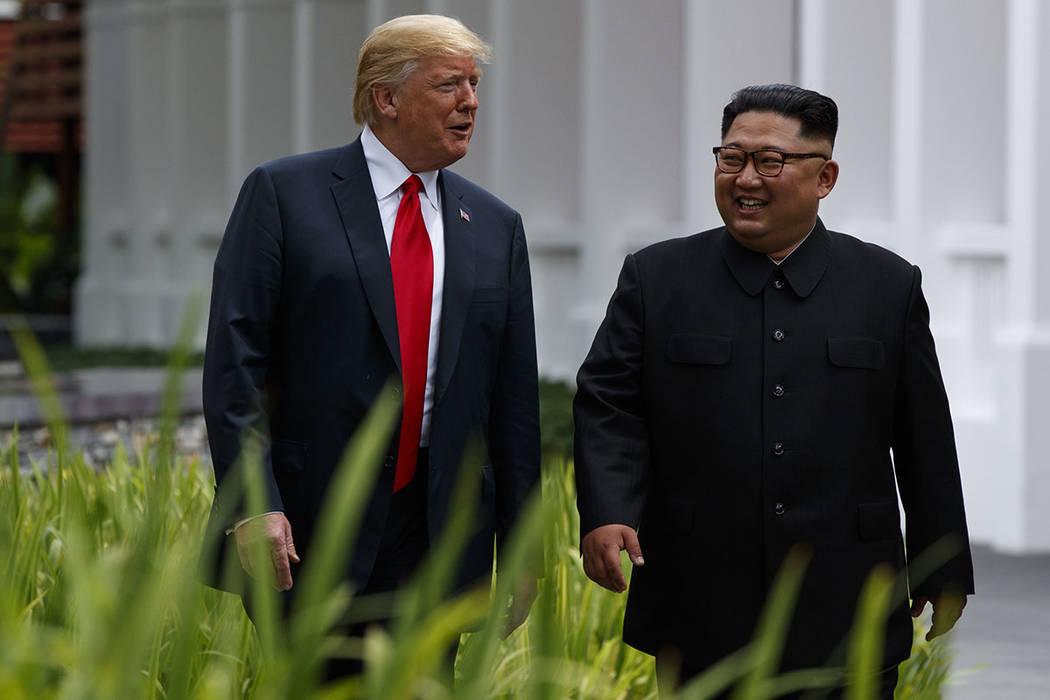 President Donald Trump walks with North Korean leader Kim Jong Un on Sentosa Island, Tuesday, June 12, 2018, in Singapore. (AP Photo/Evan Vucci)
