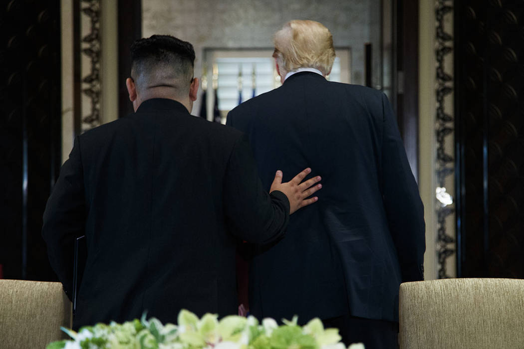 President Donald Trump and North Korean leader Kim Jong Un walk off after a signing ceremony during a meeting on Sentosa Island, Tuesday, June 12, 2018, in Singapore. (AP Photo/Evan Vucci)