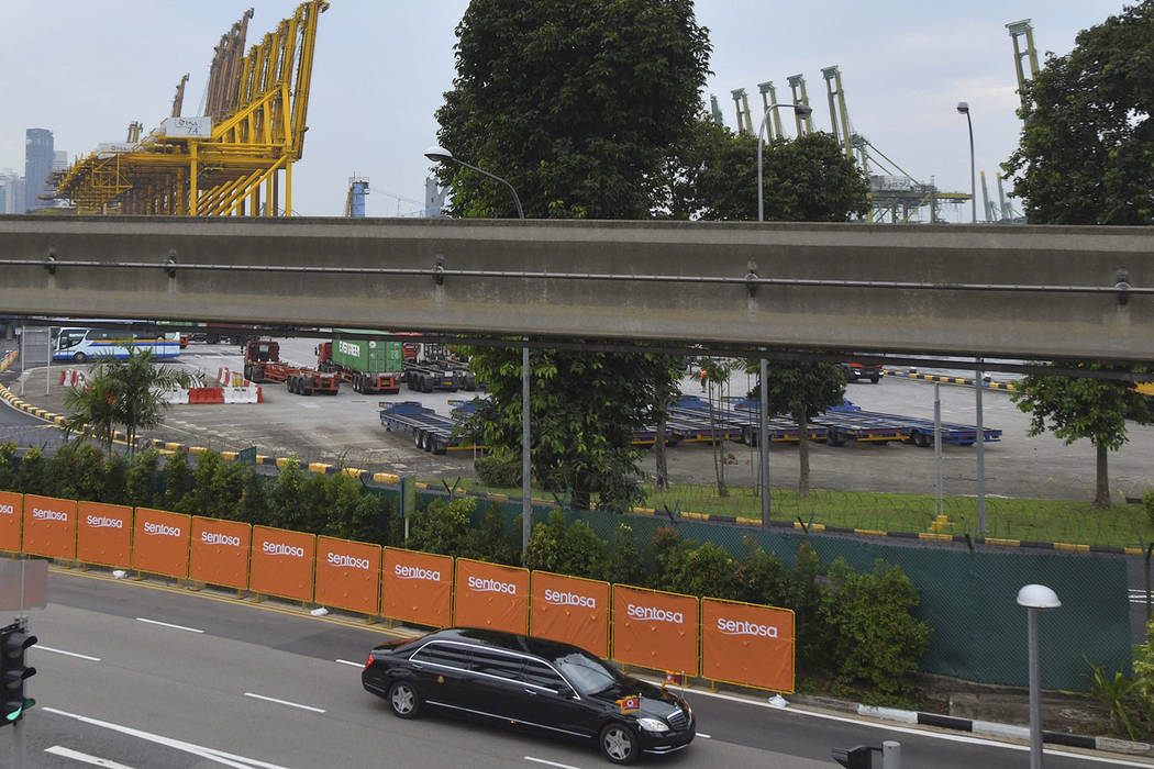 The limousine of North Korean leader Kim Jong Un drives past the port of Singapore on the way to the Capella Hotel in Singapore on Tuesday, June 12, 2018, where the summit between Kim and U.S. Pre ...