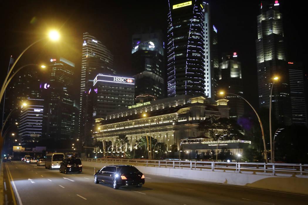 A car carrying North Korean leader Kim Jong Un's drives through downtown Singapore on Monday, June 11, 2018. (Wong Maye-E/AP)