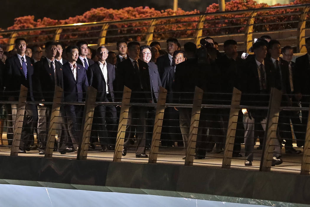 North Korea leader Kim Jong Un, center, is escorted by his security delegation as he visits Marina Bay in Singapore, Monday, June 11, 2018, ahead of Kim's summit with U.S. President Donald Trump. ...