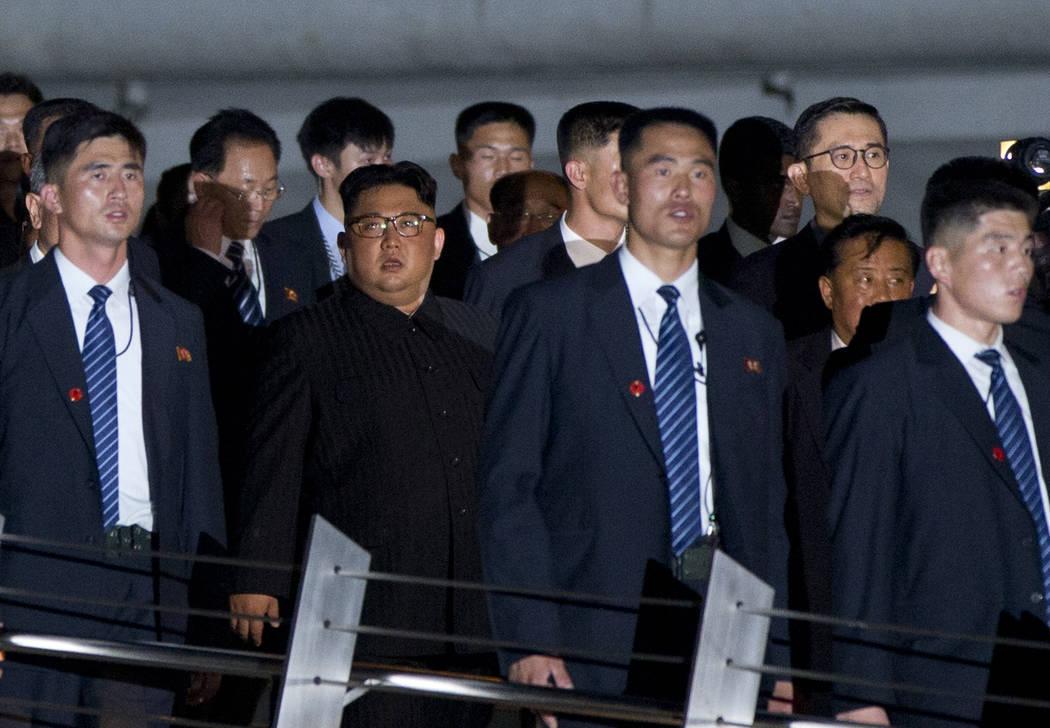 North Korean leader Kim Jong Un, center, walks in Marina Bay, Singapore Monday, June 11, 2018 ahead of the summit with U.S. President Donald Trump. (Gemunu Amarasinghe/AP)